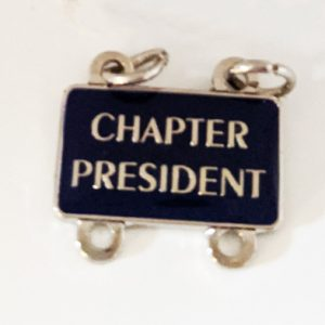 "Enamel attachment with ""Chapter President"" text"
