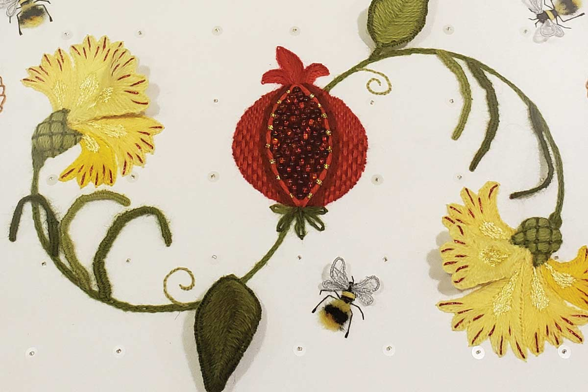 Photo of embroidered flowers and bees