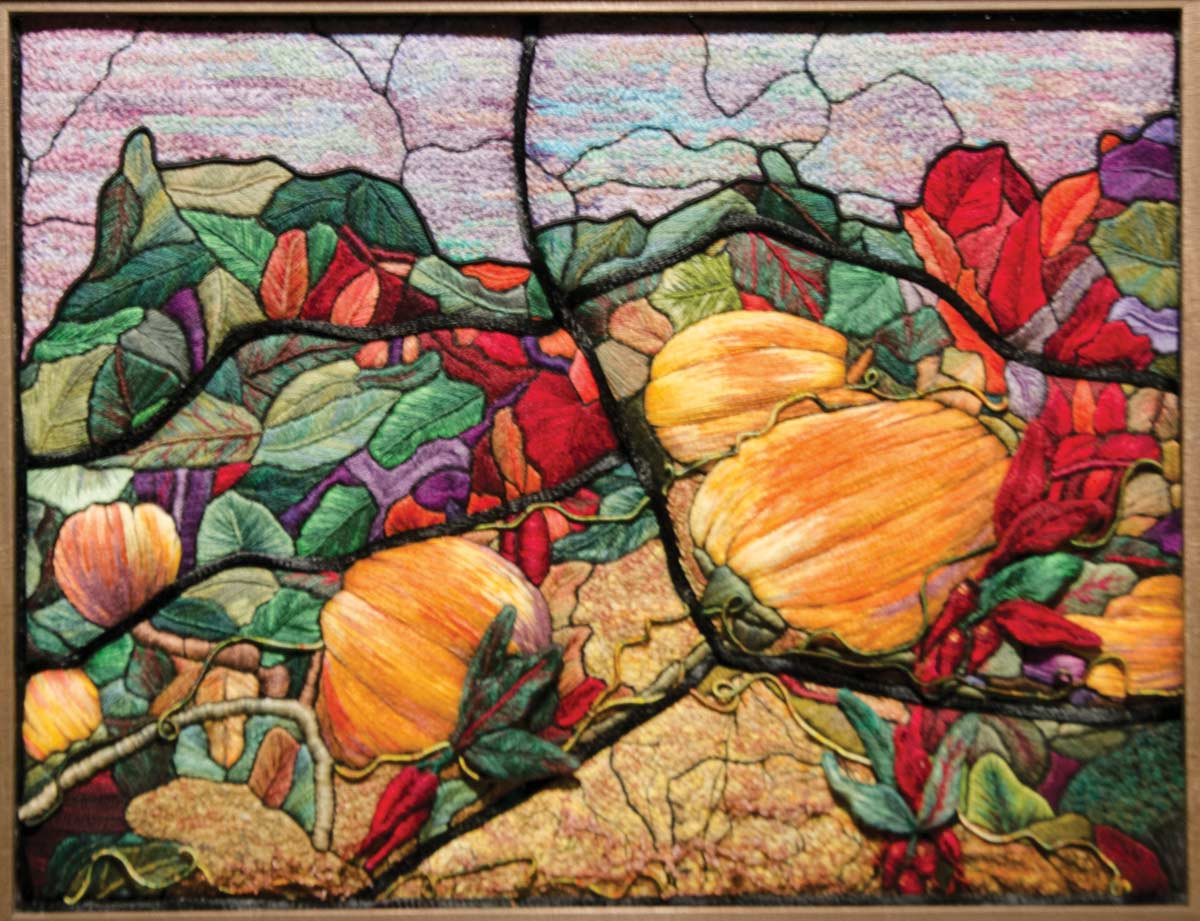 photo of an embroidered field of pumpkins