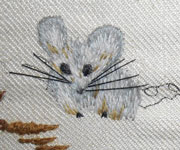 small embroidered mouse