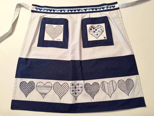 photo of an apron with blue embroidery