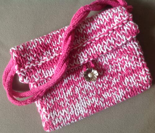 photo of a pink and white knitted pouch