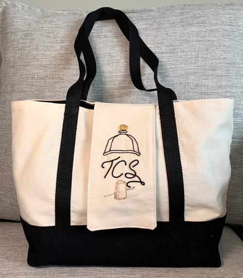 photo of a tote bag with embroidery on it