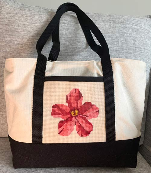 photo of a tote with an embroidered flower on it