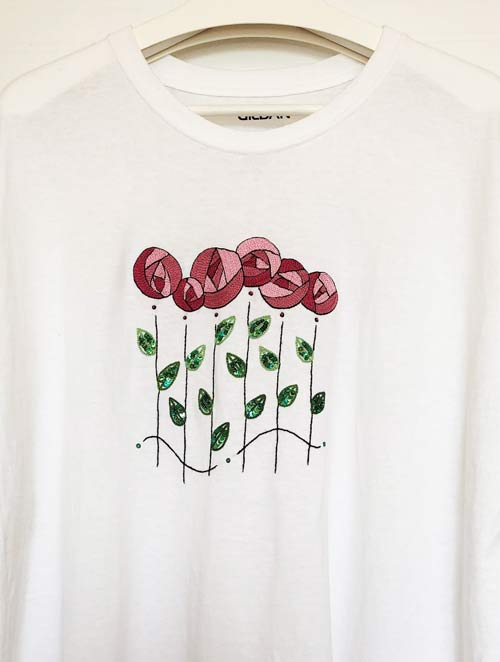 photo of the front of a t-shirt with embroidered stylized roses